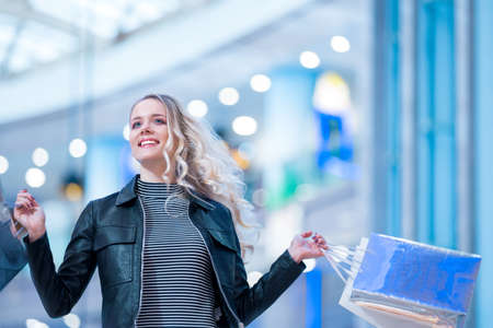 Smiling woman with shopping bag Stock Photo