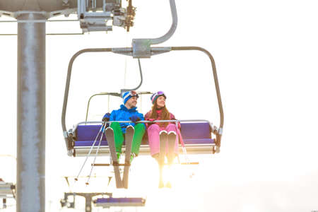 ropeway: Young couple in sportswear on a lift
