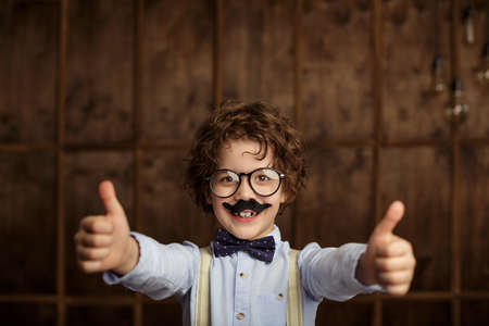 thumbup: Smiling boy with a mustache Stock Photo
