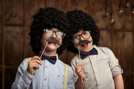 wigs: Little boys with wigs in studio