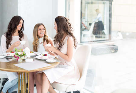 Beautiful smiling girls in cafe Stock Photo