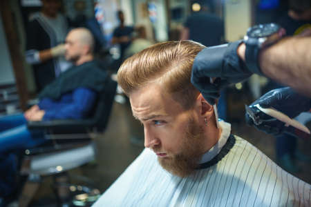 barber shop: Young hipster in barber shop Stock Photo