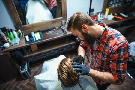 barber shop: Young hairdresser in barber shop
