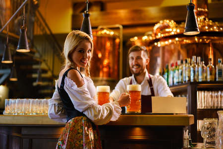 Young waitress and bartender in bar Stock Photo