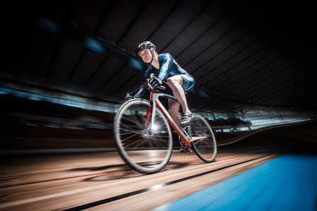 Athlete with a bicycle at velodrome Foto de archivo
