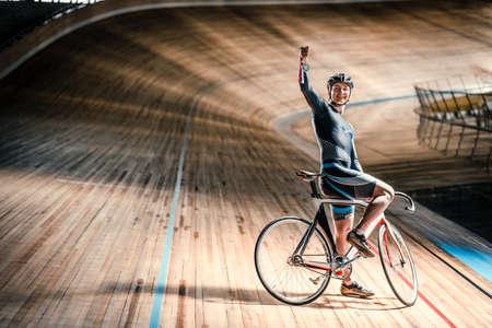 velodrome: Smiling athlete with bicycle Stock Photo