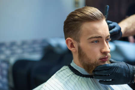 barber shop: Young man in barber shop