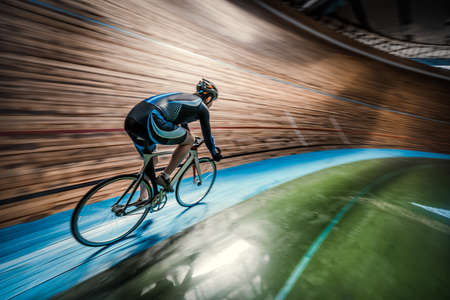 Athlete with a bicycle at velodrome Standard-Bild