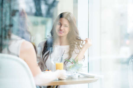 Smiling woman in a cafe photo
