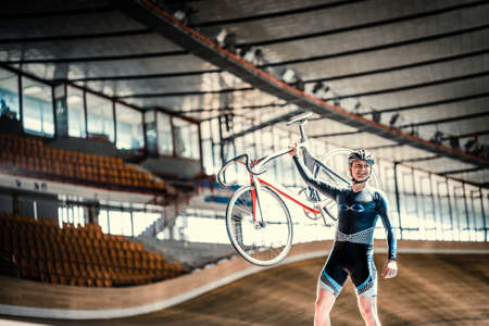 velodrome: Athlete with a bicycle at velodrome Stock Photo
