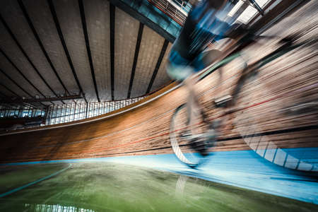 Athlete on cycle indoors Stockfoto