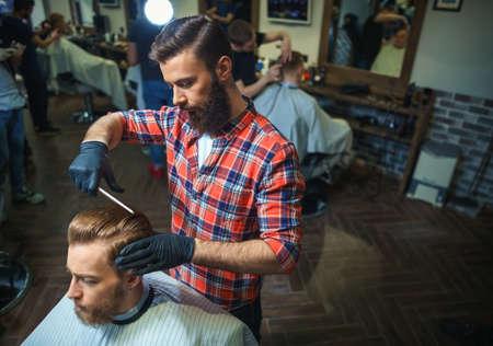 barber shop: Working hairdresser in barber shop