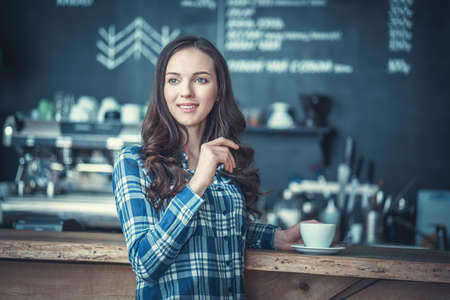 Young girl in cafe Stock Photo