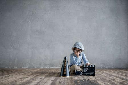 cinematographer: Sad boy with clapper in studio Stock Photo