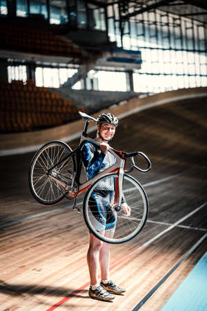 velodrome: Athlete with a bicycle on velodrome