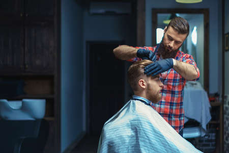 barber shop: Young customer in barber shop Stock Photo