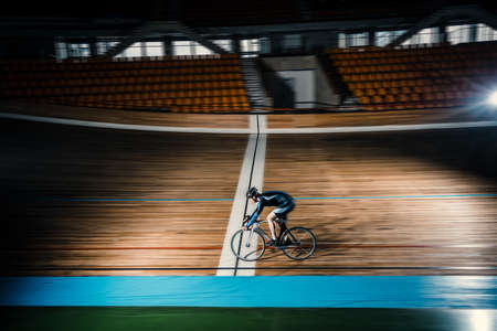 velodrome: Young cyclist on a velodrome