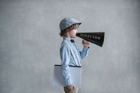 Boy with a megaphone in studio