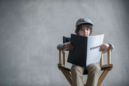 Little boy with a screenplay Stock Photo