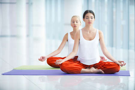 Young women in lotus position photo