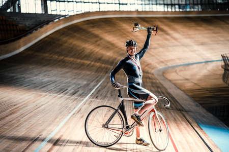 velodrome: Smiling sportsman on a velodrome Stock Photo