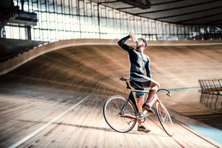 Young man on a velodrome