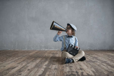 cinematographer: Screaming boy with a megaphone Stock Photo