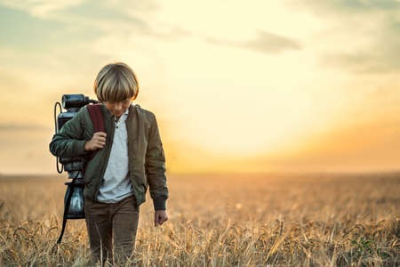 Boy with a technological backpack Stock Photo