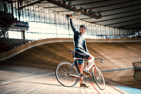 Smiling man on a velodrome Stock Photo