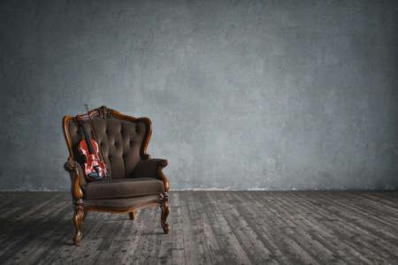 Violin on a chair indoors Stok Fotoğraf