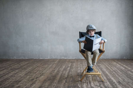 Little boy with screenplay indoors