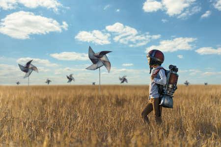 Little boy in helmet in a field Stock Photo