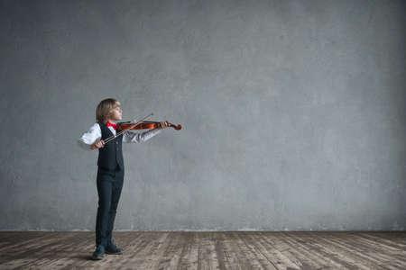 Little boy playing a violin