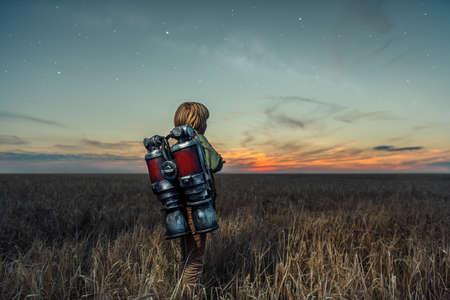 Little boy in a wheat field Stock Photo