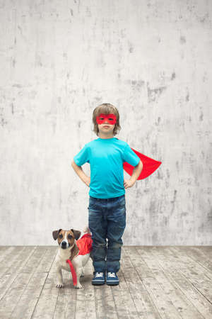 Little boy with dog in studio Stock Photo