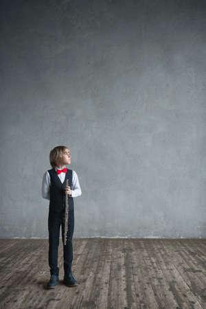 Little boy with flute in studio
