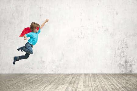 Flying superhero in studio Foto de archivo