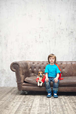Little boy with dog indoors