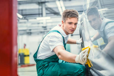Young man with car in service Stock Photo