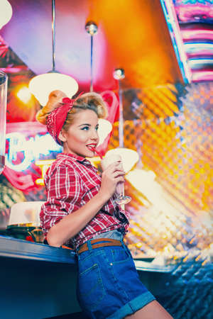 Young beautiful girl in cafe Stock Photo