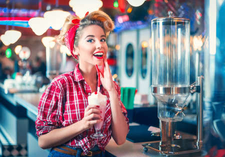 Young pin-up girl with milkshake Banco de Imagens