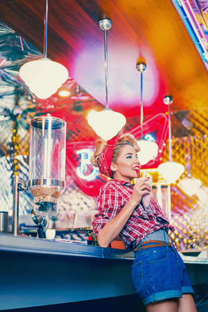 Pin-up girl in retro cafe Stock Photo