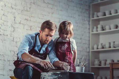 Working potters in studio Stock Photo