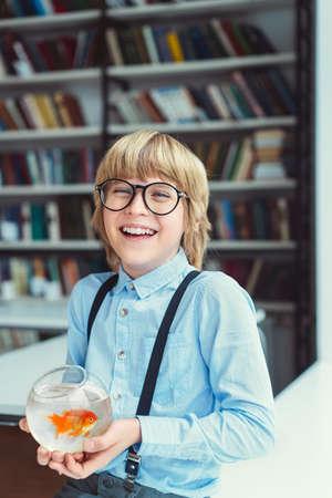 Happy boy with goldfish Stock Photo