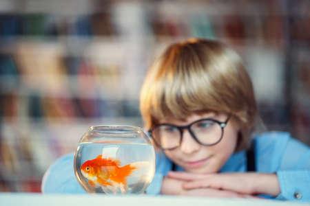 public aquarium: Smiling child with goldfish