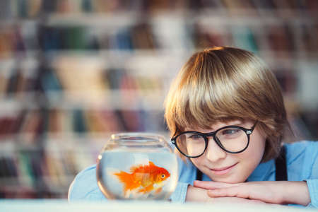 public aquarium: Smiling child with aquarium