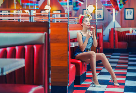 Beautiful young woman in retro style Imagens