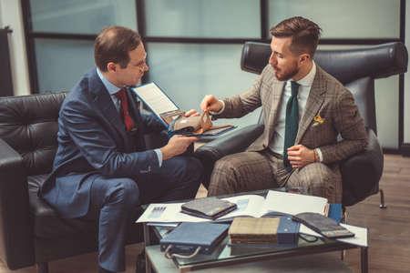 Men discussing in the studio Stok Fotoğraf