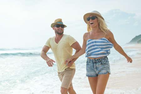 Active couple on the beach