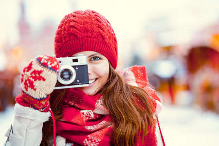 Young photographer in winter